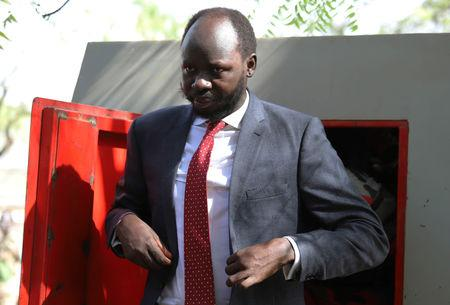 Peter Biar Ajak, the South Sudan country director for the London School of Economics' International Growth Centre based in Britain, arrives at the courtroom in Juba, South Sudan March 21, 2019. REUTERS/Stringer