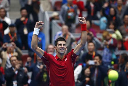 Novak Djokovic of Serbia celebrates after winning against Andy Murray of Britain during their men's singles semi-final match at the China Open tennis tournament in Beijing October 4, 2014. REUTERS/Petar Kujundzic