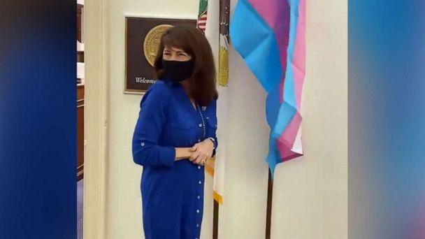 PHOTO: Rep. Marie Newman displays a transgender pride flag in front of her office in Washington, in an image made from video posted to her Twitter account on Feb. 24, 2021. (RepMarieNewman/Twitter)