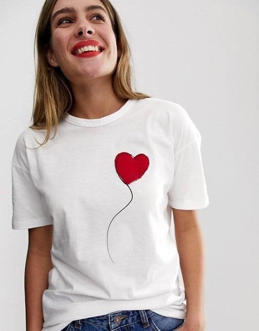 """<p>The graphic on this <a href=""""https://www.popsugar.com/buy/Wednesday-Girl-Relaxed-T-Shirt-569684?p_name=Wednesday%27s%20Girl%20Relaxed%20T-Shirt&retailer=asos.com&pid=569684&price=19&evar1=fab%3Aus&evar9=47433715&evar98=https%3A%2F%2Fwww.popsugar.com%2Fphoto-gallery%2F47433715%2Fimage%2F47433853%2FWednesday-Girl-Relaxed-T-Shirt&list1=shopping%2Ct-shirts%2Ctops%2Cfashion%20shopping&prop13=api&pdata=1"""" class=""""link rapid-noclick-resp"""" rel=""""nofollow noopener"""" target=""""_blank"""" data-ylk=""""slk:Wednesday's Girl Relaxed T-Shirt"""">Wednesday's Girl Relaxed T-Shirt </a> ($19) is cool.</p>"""