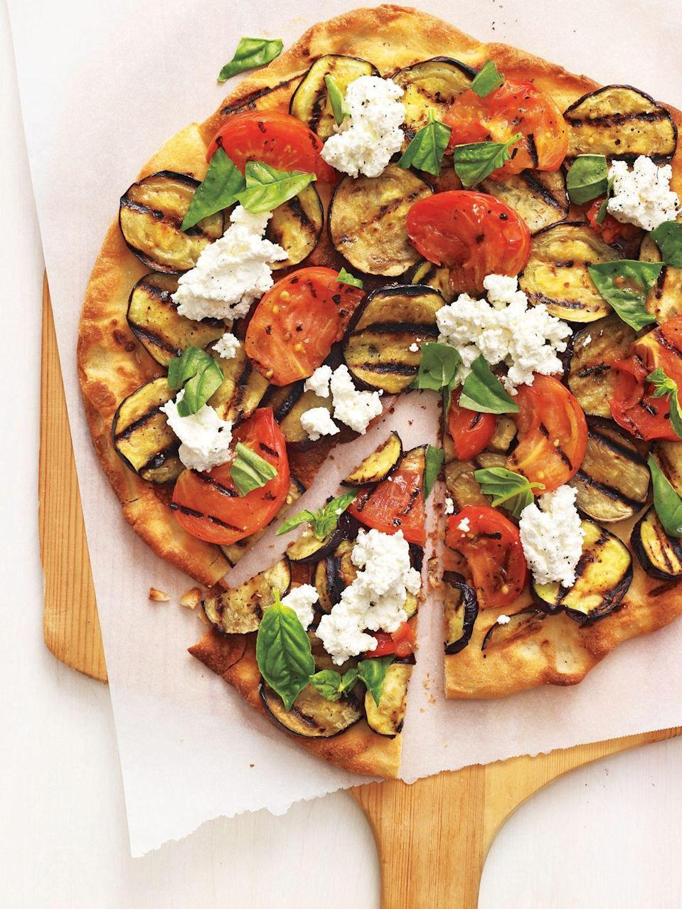 "<p>Take the flavors of Eggplant Parmesan and transform them into a mouthwatering pie with store-bought dough and generous dollops of ricotta.</p><p><em><a href=""https://www.womansday.com/food-recipes/food-drinks/recipes/a11722/grilled-eggplant-parmesan-pizza-recipe-122958/"" rel=""nofollow noopener"" target=""_blank"" data-ylk=""slk:Get the recipe from Woman's Day »"" class=""link rapid-noclick-resp"">Get the recipe from Woman's Day »</a></em></p>"