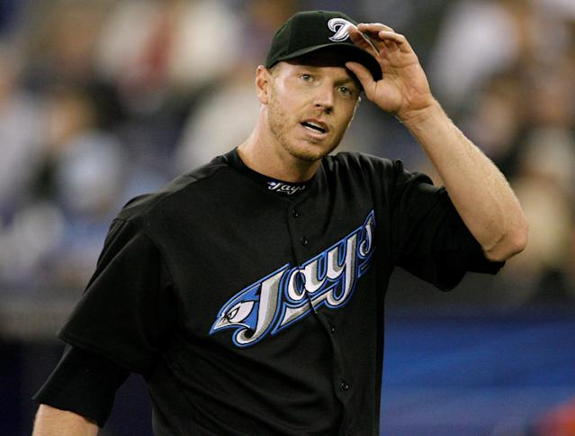 FILE PHOTO: Toronto Blue Jays starting pitcher Roy Halladay adjusts his cap while walking off the field against the Chicago White Sox during the fourth inning of their MLB American League baseball game in Toronto, Ontario, Canada May 4, 2008. REUTERS/ Mike Cassese/File Photo