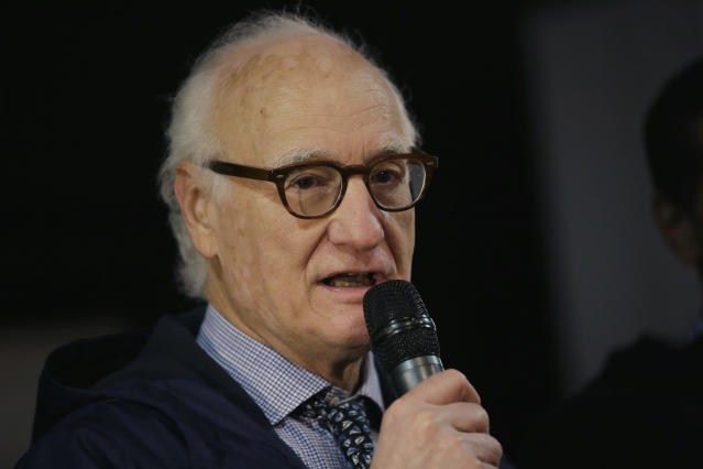 """FILE - In this Tuesday, Feb. 13, 2018 file photo, Chelsea FC chairman Bruce Buck speaks during the Qatar National Sports Day 2018 event at Stamford Bridge Stadium, in London. Railing against attempts to make soccer more equal, Chelsea chairman Buck said on Thursday, Oct. 11, 2018 that big teams should not be forced to join the """"great unwashed"""" through new regulations. (AP Photo/Tim Ireland, File)"""