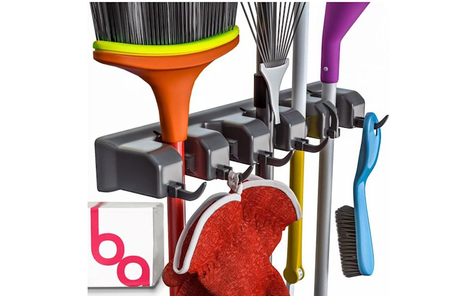 """Get those<a href=""""https://amzn.to/3lGsSfS"""" target=""""_blank"""" rel=""""noopener noreferrer"""">brooms, mops, rakes and other cleaning tools</a>off your floors, out of the closets and neatly organized once and for all with this organizer. It includes six hooks and five slots for storing handles. You won't believe how you've gone this long without it.<a href=""""https://amzn.to/3lGsSfS"""" target=""""_blank"""" rel=""""noopener noreferrer"""">Get it on Amazon</a>."""