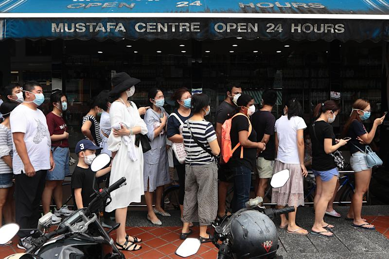 People queue to buy protective masks at Mustafa Centre on 8 February, 2020. (Getty Images file photo)