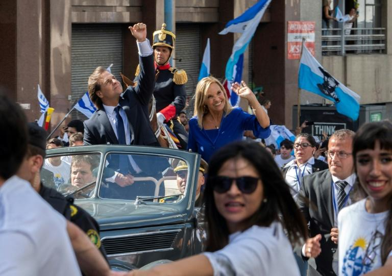Uruguay's new President Luis Lacalle Pou (L) and Vice-President Beatriz Argimon at his inauguration in Montevideo (AFP Photo/PABLO PORCIUNCULA)