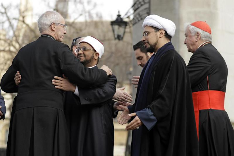 Coming together: The Archbishop of Canterbury, Justin Welby, left, embraces Sheikh Ezzat Khalifa as Sheikh Mohammad al Hilli and Cardinal Vincent Nichols, Archbishop of Westminster (AP)