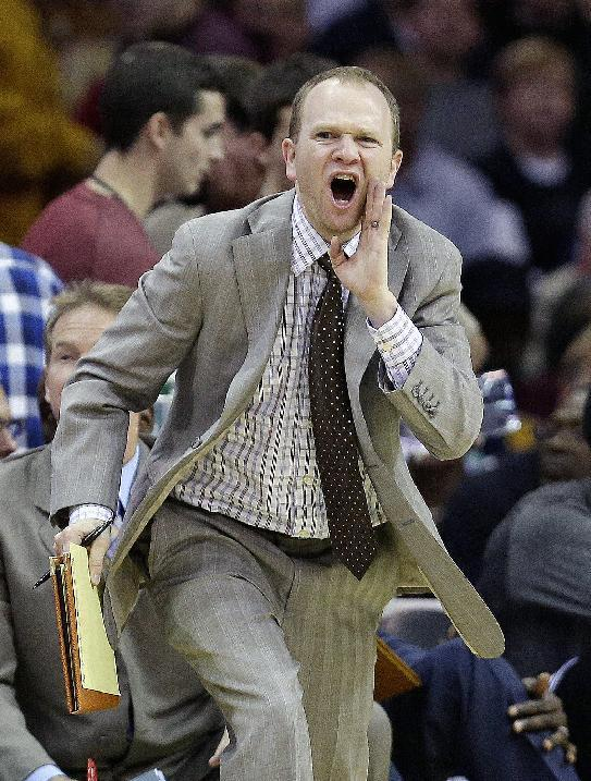 Brooklyn Nets assistant coach Lawrence Frank reacts during the second quarter of an NBA basketball game against the Cleveland Cavaliers, Wednesday, Oct. 30, 2013, in Cleveland. (AP Photo/Tony Dejak)