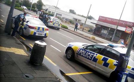 Police officers respond following shooting at Linwood in Christchurch, New Zealand, March 15, 2019, in this still image obtained from a social media video.   Video obtained by Reuters/ via REUTERS