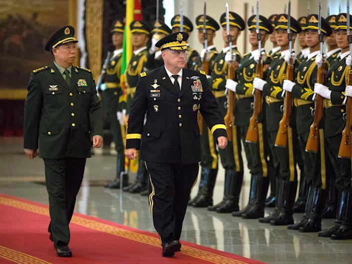 China's People's Liberation Army General Li Zuocheng and then-US Army Chief of Staff General Mark Milley review an honour guard during a welcome ceremony at the Bayi Building in Beijing on August 16, 2016 (AFP via Getty Images)