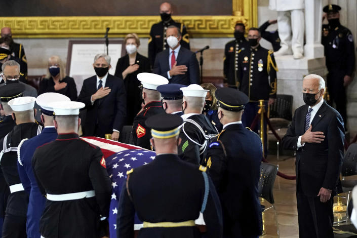 "President Joe Biden stands as a joint services honor guard carries the flag-draped casket of U.S. Capitol Police officer William ""Billy"" Evans, to where he will lie in honor at the Capitol in Washington, Tuesday, April 13, 2021. (Amr Alfiky/The New York Times via AP, Pool)"