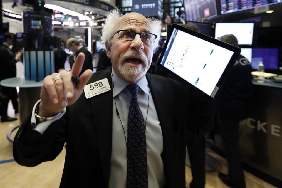 Trader Peter Tuchman works on the floor of the New York Stock Exchange, Monday, Jan. 27, 2020. Stock tumbled at the open on Wall Street following a sell-off in markets in Europe and Japan as investors grow more concerned about the potential economic impact of an outbreak of a deadly coronavirus. (AP Photo/Richard Drew)