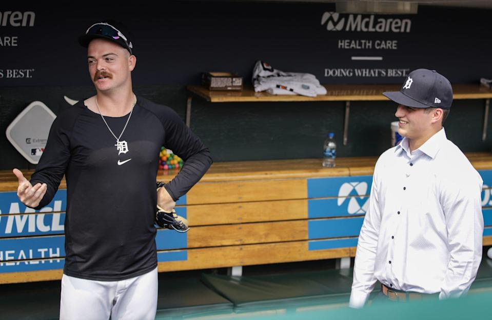 Jake Rogers and Ty Madden, just two guys from Texas, talkin' baseball in the Tigers dugout.