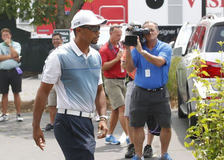 Tiger Woods of the U.S. arrives at Valhalla Golf Club for the third day of practice for the 96th PGA Championship at Valhalla Golf Club in Louisville, Kentucky, August 6, 2014. REUTERS/ John Sommers II