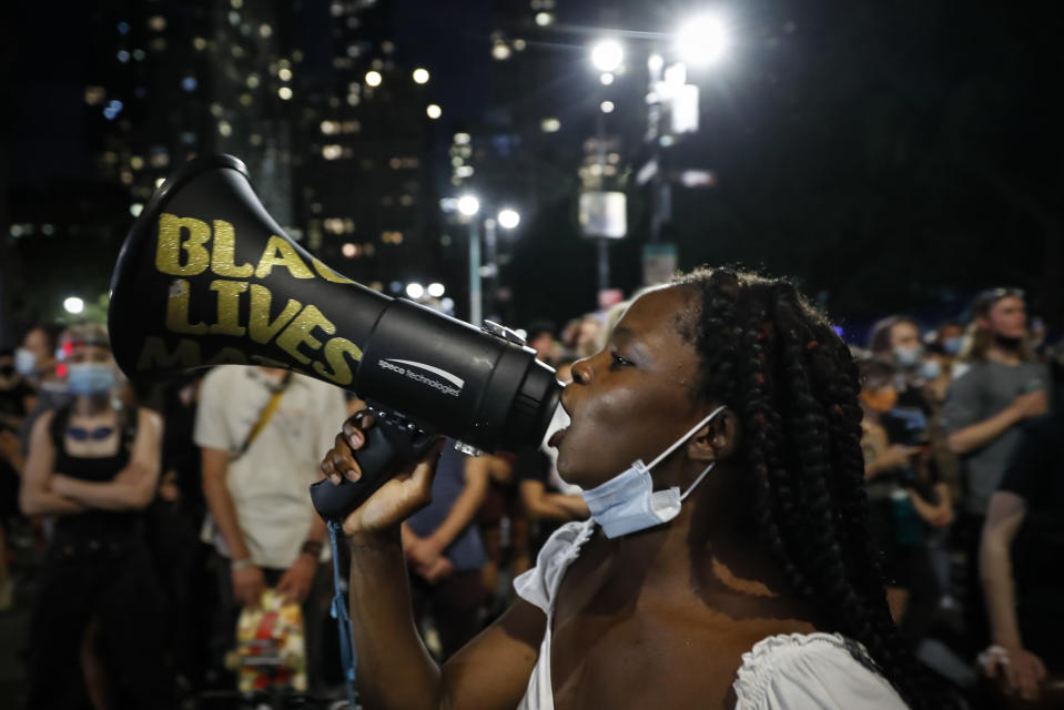 FILE - In this June 30, 2020, file photo, protesters gather at an encampment outside City Hall in New York. Thousands of Black activists from across the U.S. will hold the 2020 Black National Convention on Aug. 28, 2020, via livestream to produce a new political agenda that builds on the protests that followed George Floyd's death. Organizers of the gathering shared their plans with The Associated Press on Wednesday, July 1, ahead of an official announcement. (AP Photo/John Minchillo, File)