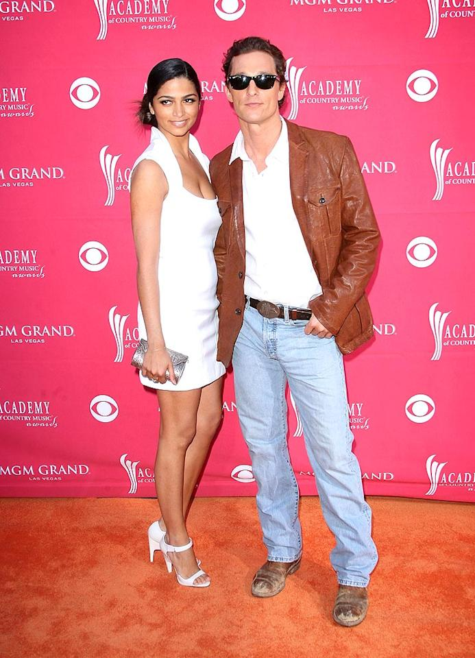 "Camila Alves sported a collared white mini and cute heels, while her main squeeze Matthew McConaughey opted for a white shirt, leather jacket, jeans, and busted boots. Jason Merritt/<a href=""http://www.gettyimages.com/"" target=""new"">GettyImages.com</a> - April 5, 2009"