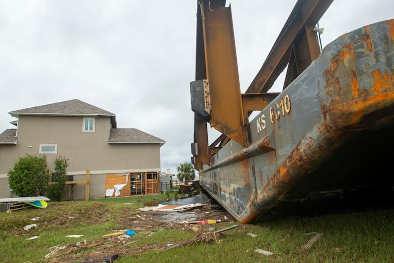 One of several Skanska USA barges that broke loose during Hurricane Sally rests near the home of Joanne Nisewonger in Pensacola, Fla., on Sept. 20, 2020.