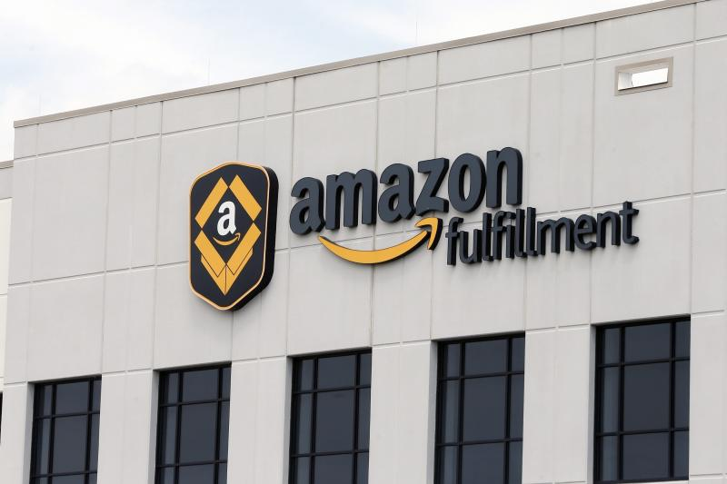 FILE - This Monday, July 8, 2019 file photo shows the Amazon Fulfillment warehouse in Shakopee, Minn. Amazon is on the hunt for workers. The online shopping giant is looking to fill more than 30,000 vacant jobs by early next year, and is holding job fairs across the country next week to find candidates. The job fairs will take place Sept. 17, 2019 in six U.S. cities: Arlington, Virginia; Boston; Chicago; Dallas, Texas; Nashville, Tennessee; and Seattle. (AP Photo/Jim Mone, File)