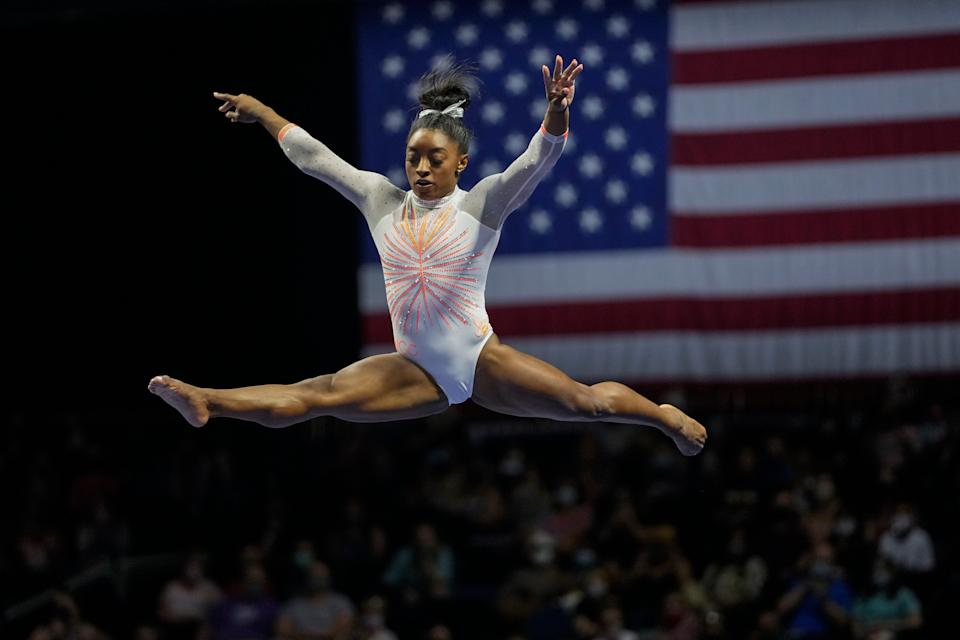 <p>Simone Biles performs her balance beam routine during the U.S. Classic gymnastics competition in Indianapolis</p> ((AJ Mast/AP))