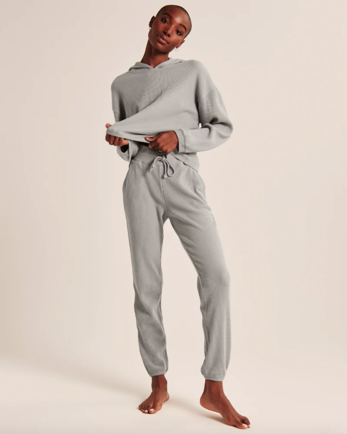 """<h2>Abercrombie & Fitch Waffle Lounge Pants & Cutoff Hoodie</h2><br><strong>Available Sizes: XXS-XL</strong><br>Tbh, A&F has never looked so desirable — we are ready to don this soft gray waffle-knit ensemble from sunrise to sunset on repeat for the rest of our stay-at-home lives.<br><br><em>Shop <strong><a href=""""https://www.abercrombie.com/shop/us/p/waffle-lounge-pants-43834319"""" rel=""""nofollow noopener"""" target=""""_blank"""" data-ylk=""""slk:Abercrombie & Fitch"""" class=""""link rapid-noclick-resp"""">Abercrombie & Fitch</a></strong></em><br><br><strong>Abercrombie and Fitch</strong> Waffle Lounge Pants, $, available at <a href=""""https://go.skimresources.com/?id=30283X879131&url=https%3A%2F%2Fwww.abercrombie.com%2Fshop%2Fus%2Fp%2Fwaffle-lounge-pants-43834319"""" rel=""""nofollow noopener"""" target=""""_blank"""" data-ylk=""""slk:Abercrombie and Fitch"""" class=""""link rapid-noclick-resp"""">Abercrombie and Fitch</a><br><br><strong>Abercrombie and Fitch</strong> Waffle Cutoff Hoodie, $, available at <a href=""""https://go.skimresources.com/?id=30283X879131&url=https%3A%2F%2Fwww.abercrombie.com%2Fshop%2Fus%2Fp%2Fwaffle-cutoff-hoodie-44001819"""" rel=""""nofollow noopener"""" target=""""_blank"""" data-ylk=""""slk:Abercrombie and Fitch"""" class=""""link rapid-noclick-resp"""">Abercrombie and Fitch</a>"""