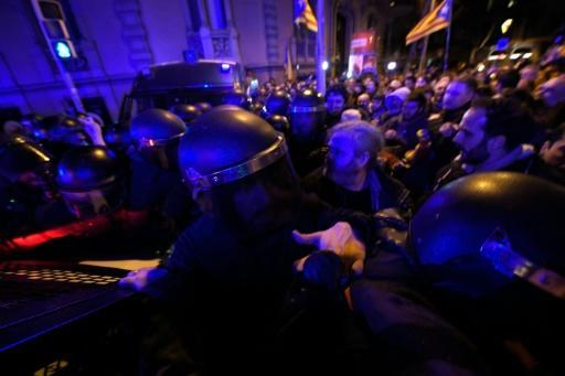 Demonstrators scuffle with riot police in Barcelona during a protest called by supporters of Catalan independence