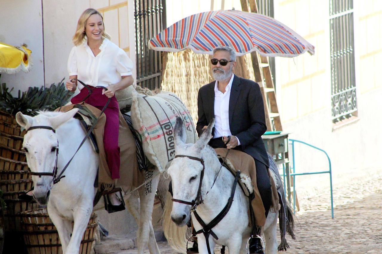 Brie Larson and George Clooney ride horses while filming a commercial in Navalcarnero, Spain, on Wednesday.