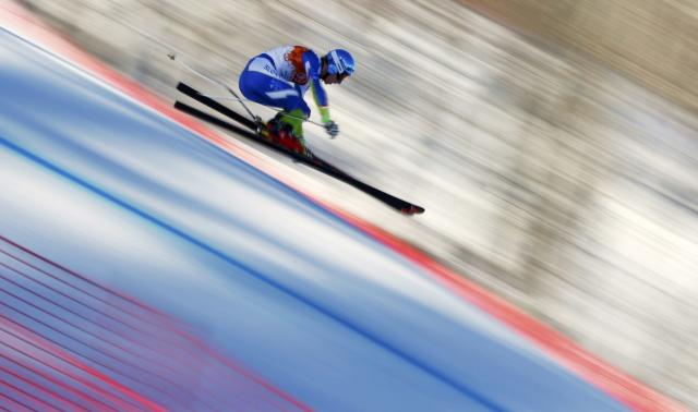 Slovenia's Klemen Kosi speeds down the course during the downhill run of the men's alpine skiing super combined event at the 2014 Sochi Winter Olympics at the Rosa Khutor Alpine Center February 14, 2014. REUTERS/Dominic Ebenbichler (RUSSIA - Tags: SPORT SKIING OLYMPICS)