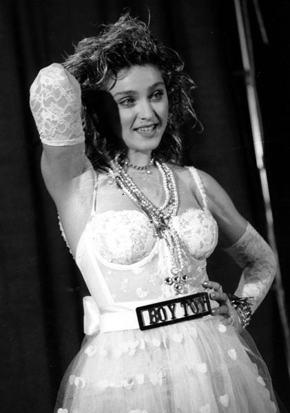"""<div class=""""caption-credit""""> Photo by: AP</div><div class=""""caption-title""""></div><b>Madonna at the MTV Music Awards in 1984</b> <br> When Madge writhed around on stage to """"Like a Virgin"""" dressed as a punky bride with her Boy Toy belt a star was born. Controversial? Yes. But also genius. <br>"""