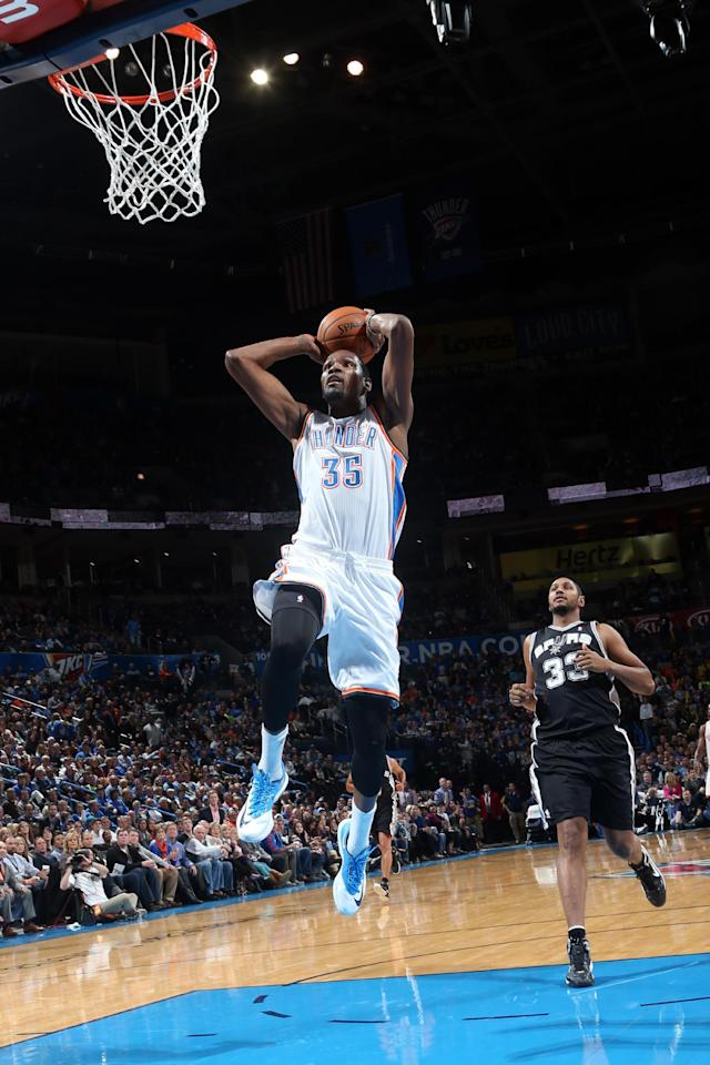 OKLAHOMA CITY, OK - NOVEMBER 27: Kevin Durant #35 of the Oklahoma City Thunder dunks against the San Antonio Spurs on November 27, 2013 at the Chesapeake Energy Arena in Oklahoma City, Oklahoma. (Photo by Layne Murdoch/NBAE via Getty Images)