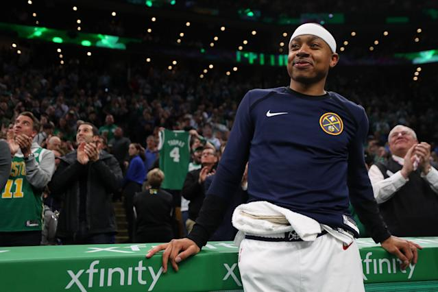 Isaiah Thomas watches a tribute video played in his honor during the first quarter Monday night in Boston. (Getty Images)