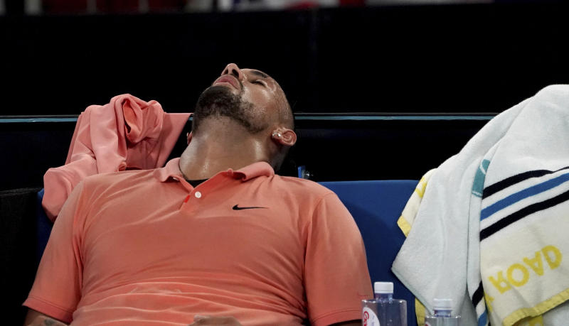 Australia's Nick Kyrgios rests in his chair after defeating Russia's Karen Khachanov in their third round singles match at the Australian Open tennis championship in Melbourne, Australia, Saturday, Jan. 25, 2020. (AP Photo/Lee Jin-man)