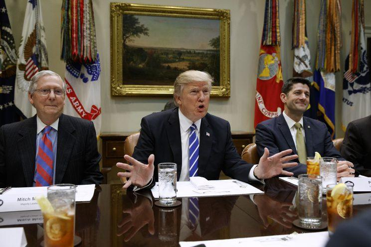 President Trump — flanked by Senate Majority Leader Mitch McConnell of Kentucky, left, and House Speaker Paul Ryan of Wisconsin — speaks during a meeting with House and Senate leadership in the Roosevelt Room of the White House in Washington on March 1, 2017. The president is deploying an outside and inside strategy to fulfill his campaign promise to repeal and replace Obamacare, seeking support beyond Washington before making an in-person pitch on Capitol Hill. (Photo: Evan Vucci/AP)