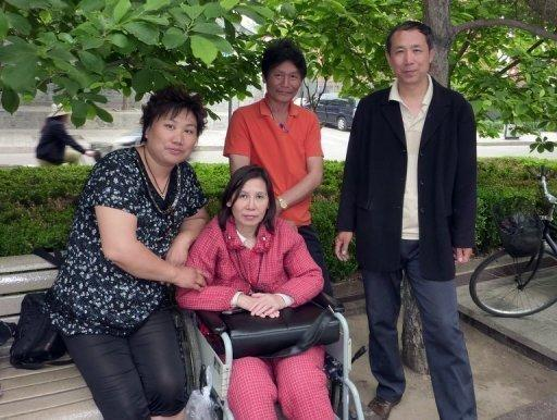 Lawyers for Ni Yulan (centre) had gone to court to challenge her 30 month jail term for fraud