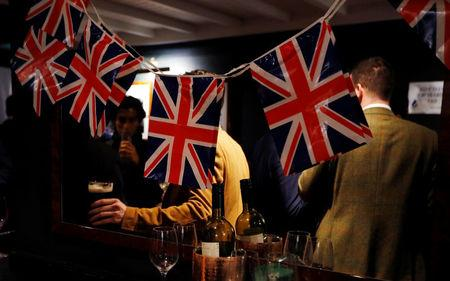 People drink beer at a Pro-Brexit event to celebrate the invoking of Article 50 after Britain's Prime Minister Theresa May triggered the process by which the United Kingdom will leave the European Union, in London