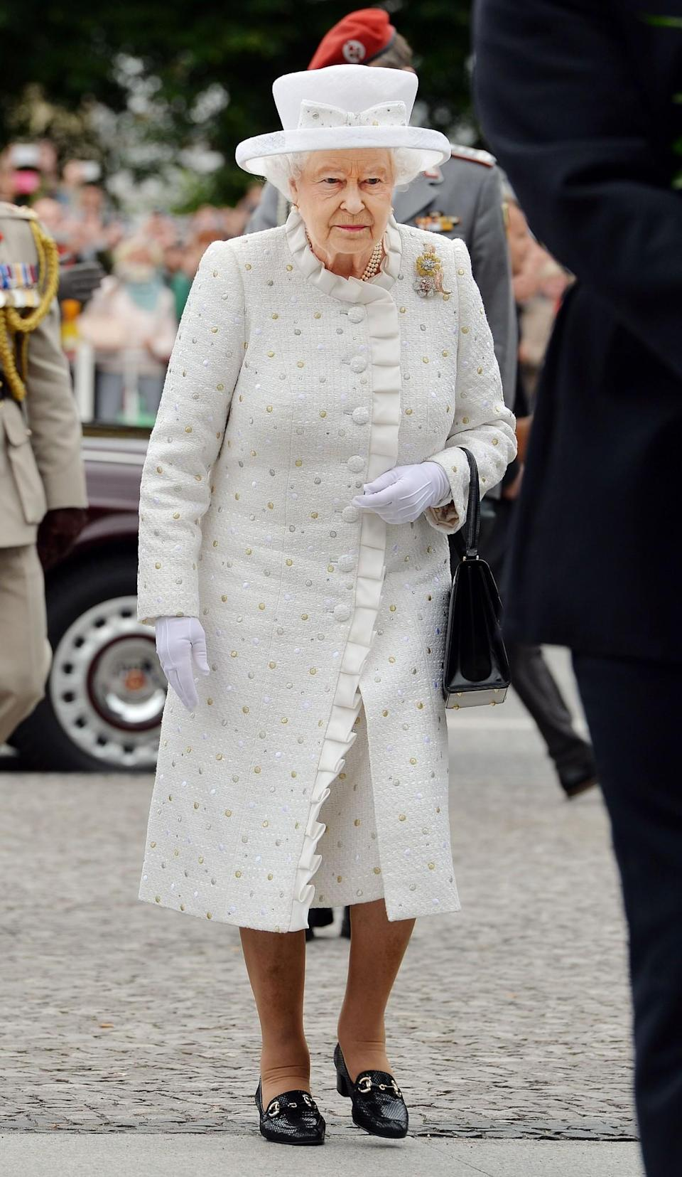 <p>Forgoing her love of colour, the Queen wore a rare cream coat and hat on a state visit to Germany.<br><i>[Photo: PA]</i> </p>