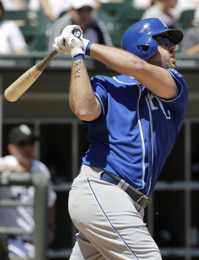 Kansas City Royals' Mike Moustakas hits an RBI single against the Chicago White Sox during the fourth inning of a baseball game in Chicago on Saturday, June 14, 2014. (AP Photo/Nam Y. Huh)