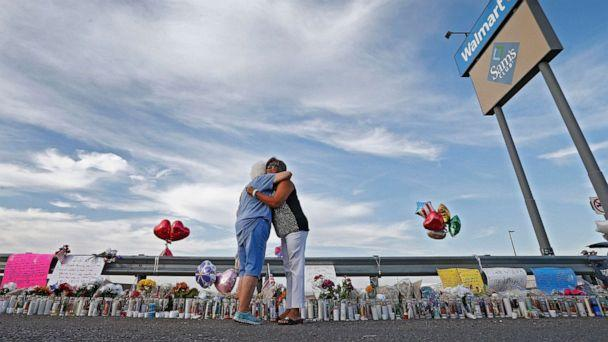 PHOTO: Emma Del Valle hugs Brenda Castaneda, right, while visiting the make-shift memorial outside the Walmart in El Paso, Texas, Aug. 5, 2019, following the mass shooting. (Larry W. Smith/EPA via Shutterstock)