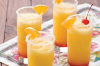 "The tequila sunrise and the margarita join forces in this refreshing cocktail mashup. <a href=""https://www.epicurious.com/recipes/food/views/frozen-sunrise-margaritas-51147200?mbid=synd_yahoo_rss"" rel=""nofollow noopener"" target=""_blank"" data-ylk=""slk:See recipe."" class=""link rapid-noclick-resp"">See recipe.</a>"