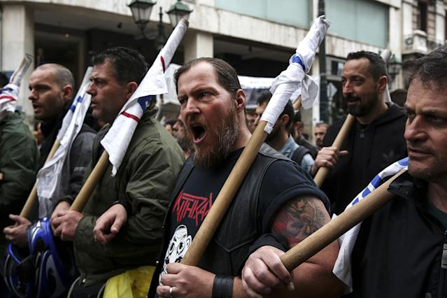 <p>Protesters chant slogans as they take part in an anti-government rally during a 24-hour labour strike in Athens, Greece, on Wednesday, May 17, 2017. Greeces economy returned to recession in the first quarter as delays in concluding talks between the government and its creditors raised the specter of another debt drama. (Yorgos Karahalis/Bloomberg via Getty Images) </p>