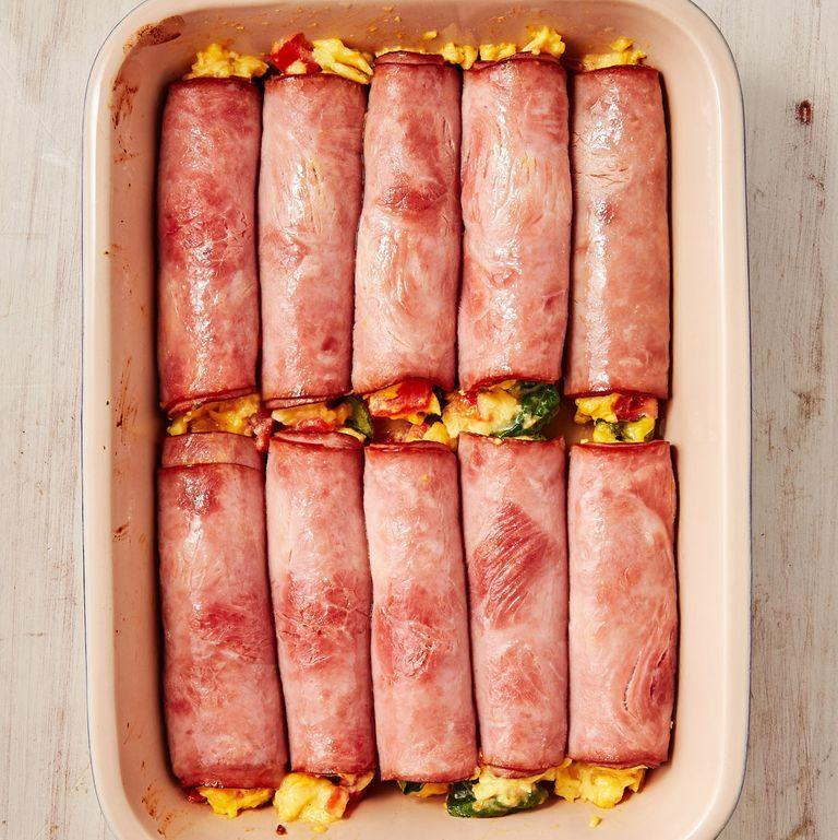 """<p>These roll-ups are the perfect low-carb substitute to your favourite <a href=""""https://www.delish.com/uk/cooking/recipes/a30499789/breakfast-burrito/"""" rel=""""nofollow noopener"""" target=""""_blank"""" data-ylk=""""slk:Breakfast Burrito"""" class=""""link rapid-noclick-resp"""">Breakfast Burrito</a>. Easy enough to make for a crowd and the filling possibilities are endless! Start your morning off on the right foot. </p><p>Get the <a href=""""https://www.delish.com/uk/cooking/recipes/a34411412/ham-egg-cheese-roll-ups-recipe/"""" rel=""""nofollow noopener"""" target=""""_blank"""" data-ylk=""""slk:Ham Egg & Cheese Roll-Ups"""" class=""""link rapid-noclick-resp"""">Ham Egg & Cheese Roll-Ups</a> recipe.</p>"""