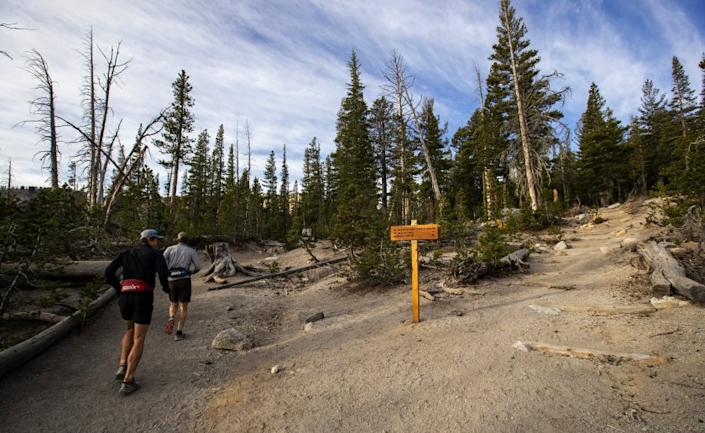 "Trail runners run past new signage and revamped trails at the Horseshoe Lake Trailhead in Mammoth Lakes in Oct. 2019. <span class=""copyright"">(Brian van der Brug / Los Angeles Times)</span>"