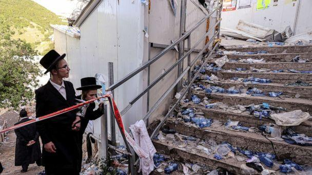 PHOTO: Ultra Orthodox Jews look at stairs littered with refuse in Mount Meron, northern Israel, where a stampede killed scores during an annual religious commemoration that include all-night prayer and dance, April 30, 2021. (Ronen Zvulun/Reuters)