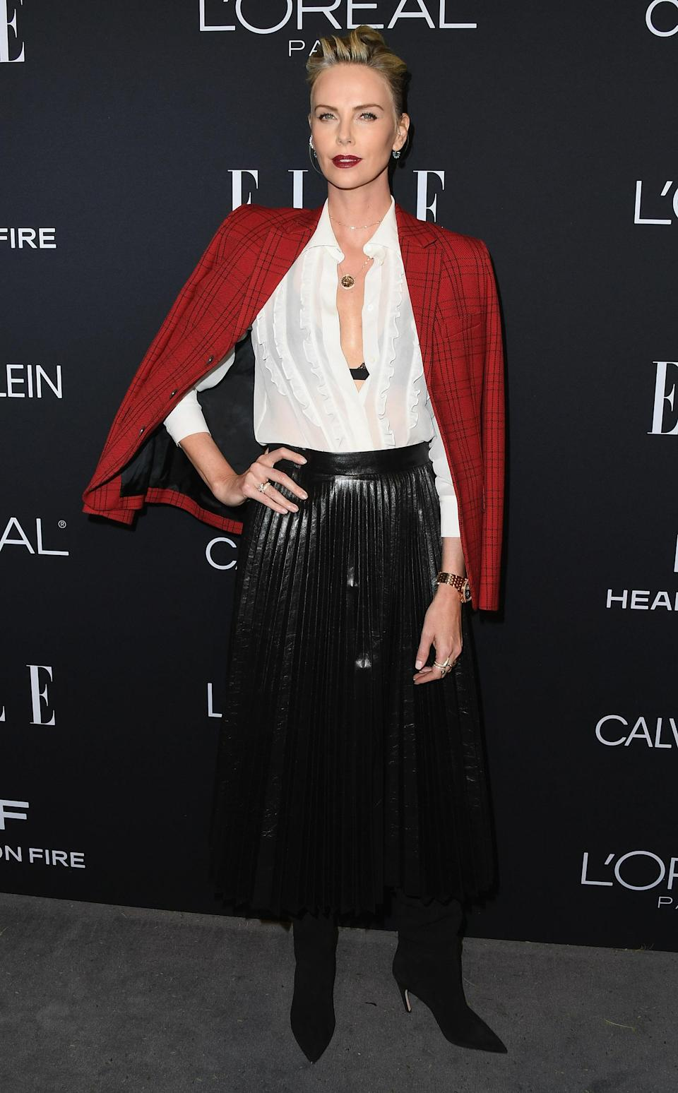<p>For the annual bash, Charlize Theron opted for a Christian Dior get-up complete with Anna Sheffield jewellery (and a gothic autumn-ready lip). <em>[Photo: Getty]</em> </p>