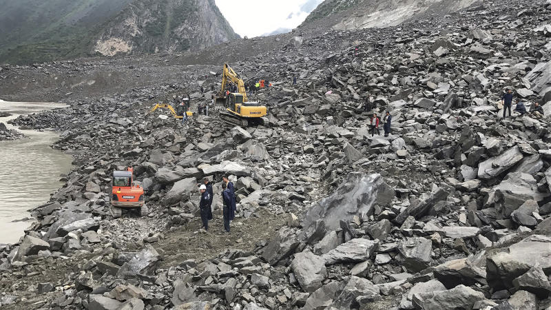 <p> Emergency personnel and earthmoving equipment work at the site of a massive landslide in Xinmo village in Maoxian County in southwestern China's Sichuan Province, Saturday, June 24, 2017. Dozens of people are feared buried by a landslide that unleashed huge rocks and a mass of earth that crashed into their homes in southwestern China early Saturday, a county government said. (Chinatopix via AP) </p>