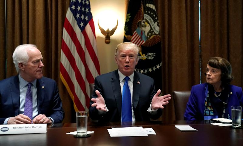 Flanked by Senators John Cornyn (R-TX) and Dianne Feinstein (D-Calif.) U.S. President Donald Trump meets with bi-partisan members of Congress to discuss school and community safety in the wake of the Florida school shootings (Kevin Lamarque / Reuters)