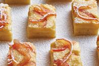 "Swap out your usual lemon bars for this tangy grapefruit version topped with sugary candied zest. Want to get ahead on your menu? The bars can be baked up to three days in advance. <a href=""https://www.epicurious.com/recipes/food/views/grapefruit-bars-with-candied-zest?mbid=synd_yahoo_rss"" rel=""nofollow noopener"" target=""_blank"" data-ylk=""slk:See recipe."" class=""link rapid-noclick-resp"">See recipe.</a>"