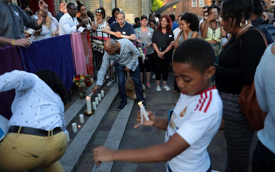 Prays are said and candles are lit outside Notting Hill Methodist Church near the 24 storey residential Grenfell Tower block in Latimer Road - Credit: Getty