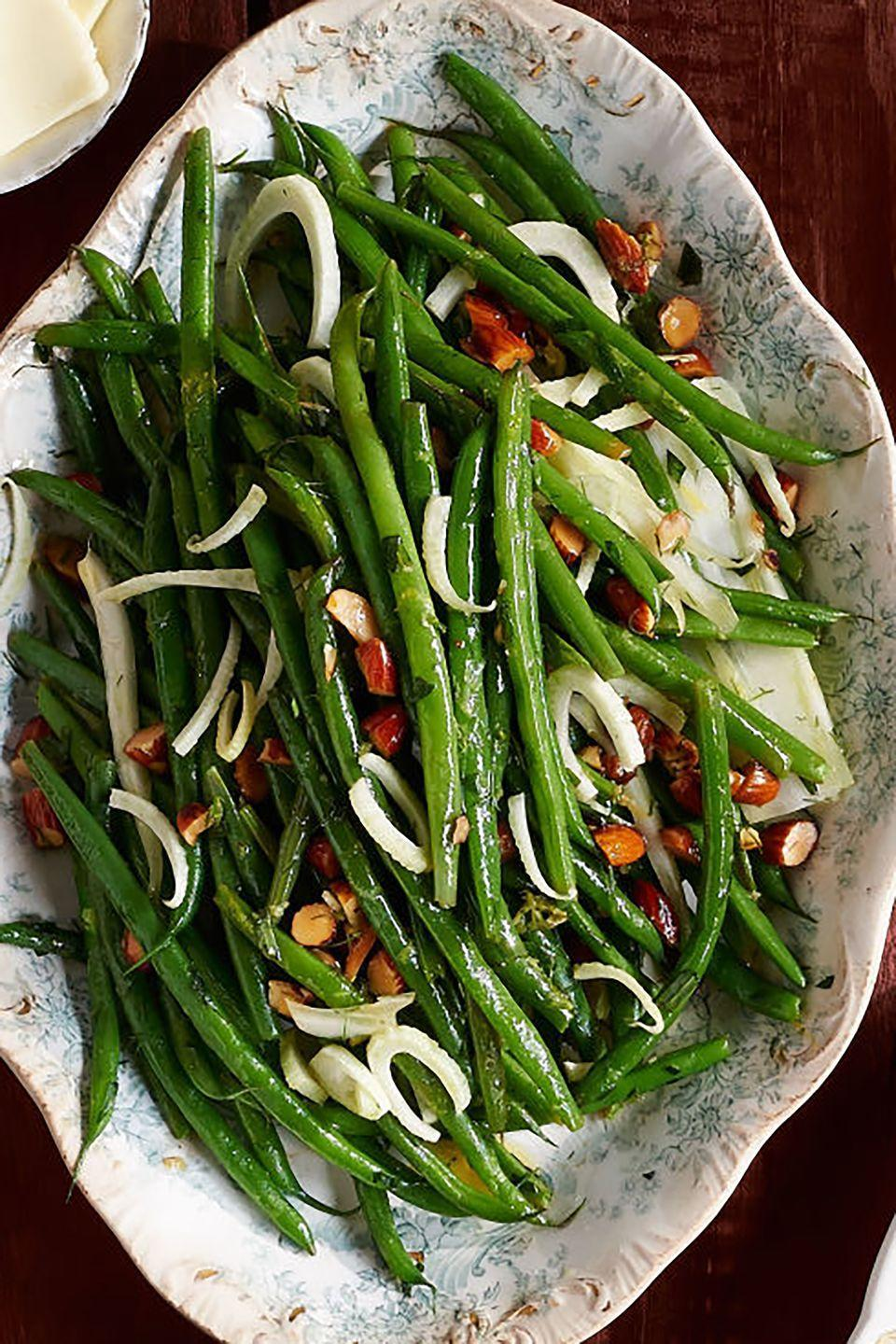 """<p>It's just a quick flash in the pan for this zesty veggie side.</p><p><strong><a href=""""https://www.countryliving.com/food-drinks/recipes/a36670/green-beans-and-fennel-with-tarragon/"""" rel=""""nofollow noopener"""" target=""""_blank"""" data-ylk=""""slk:Get the recipe"""" class=""""link rapid-noclick-resp"""">Get the recipe</a>.</strong></p>"""