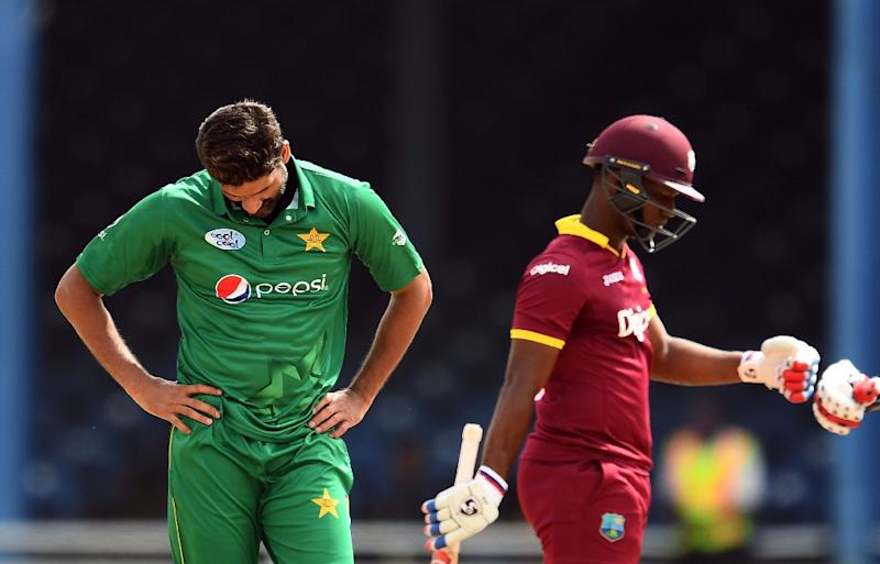 West Indies' Evin Lewis (R) celebrates as Pakistan's bowler Sohail Tanvir looks down during their T20I-match at the Queen's Park Oval in Port of Spain, Trinidad, on April 1, 2017 (AFP Photo/Jewel SAMAD)