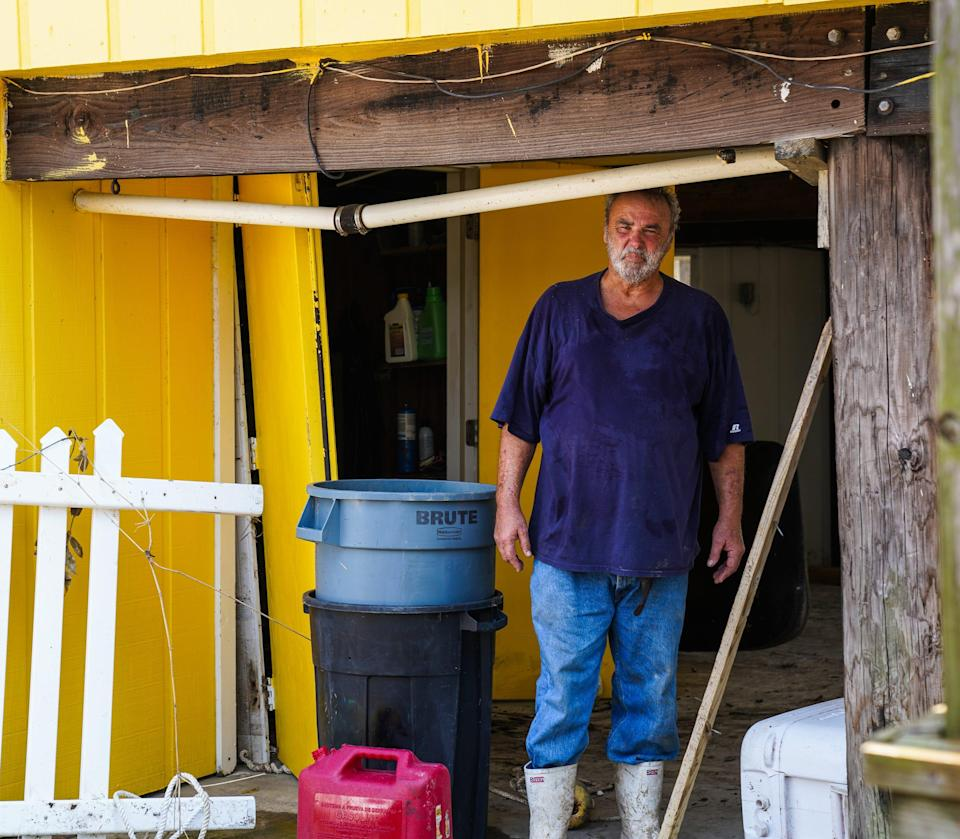 Third-generation oyster farmer Jules Melancon stands in the garage area of his home on Grand Isle, Louisiana, following the passage of Hurricane Ida.